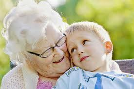 An elderly woman happy with her grandson.