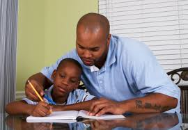 A father helping his son with homework