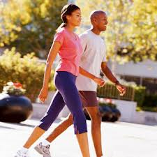 A woman and a man walking happily in workout clothing