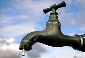 Faucet dripping clean water
