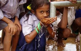 Child drinking clean water from faucet